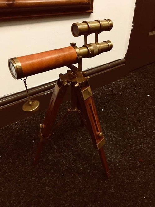 Leather and brass telescope on stand.