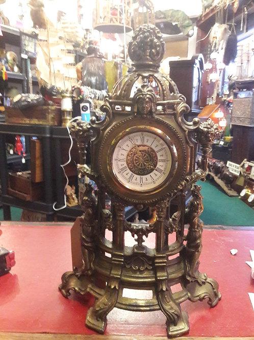 Brass manual wind mantle clock.