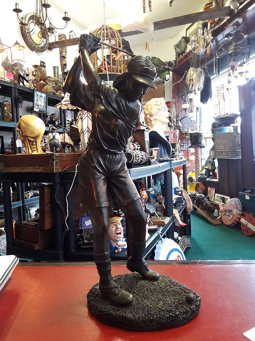 Resin cast golfing figure
