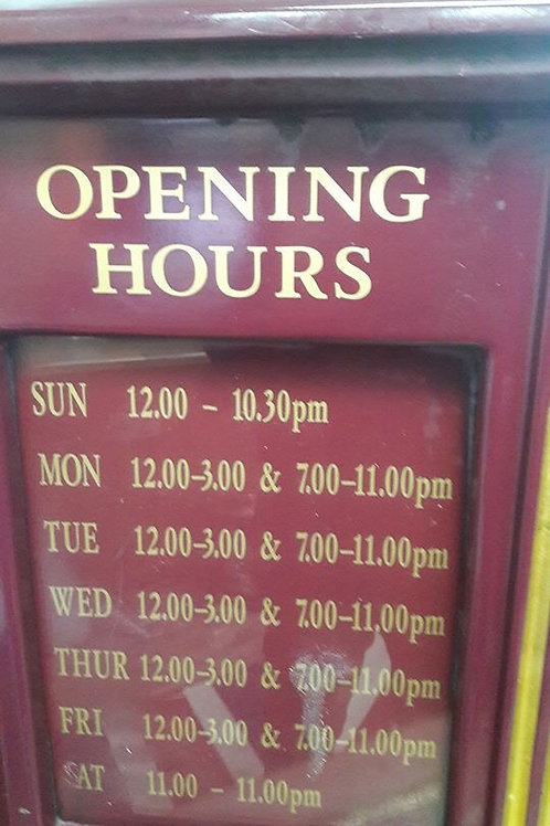Vintage Pub opening hours signs.