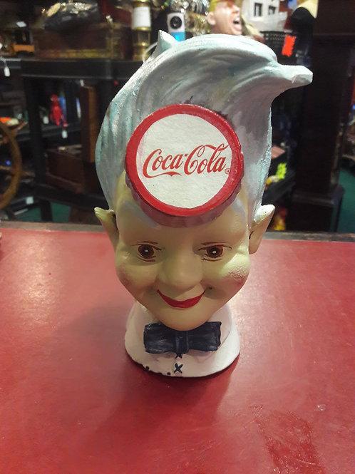 Coca Cola head money bank.