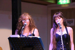 Sharon and Eleanore Duggan singing backing vocals for singing students