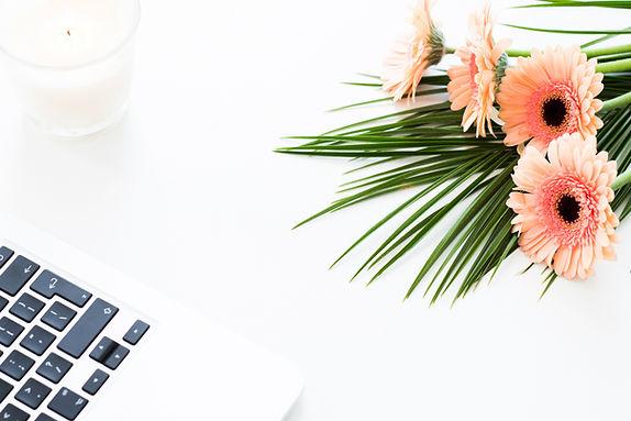 orange flowers on desk with keyboard