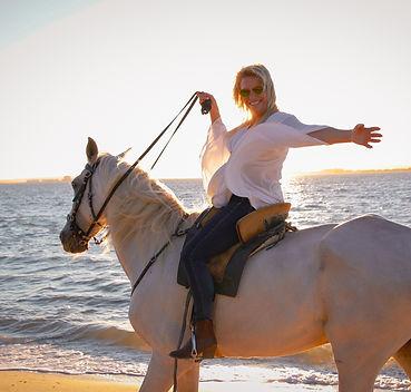 andar a cavalo na praia