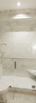 Frameless Shower with Door Hinged off Panel