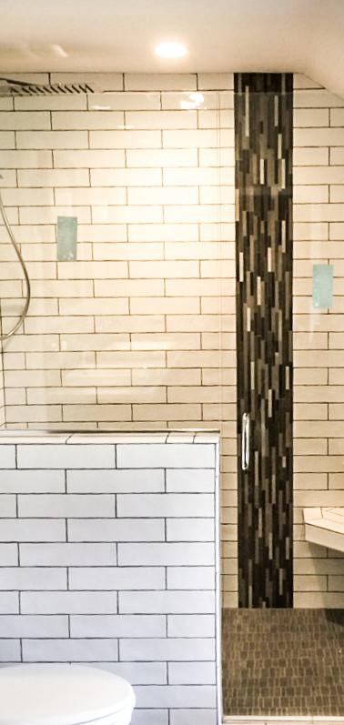 Frameless Shower Door with Panel on Buttress