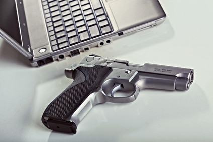 a gun and a computer, elearning for gun buyers