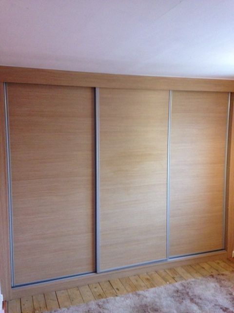 Wood effect sliding wardrobe doors