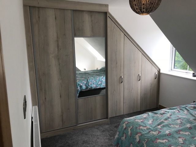 Fitted sliding door wardrobe with angled doors - Chesterfield