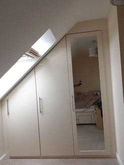 Sloping wardrobe with mirrored doors