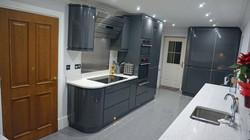 High gloss fitted kitchen designed