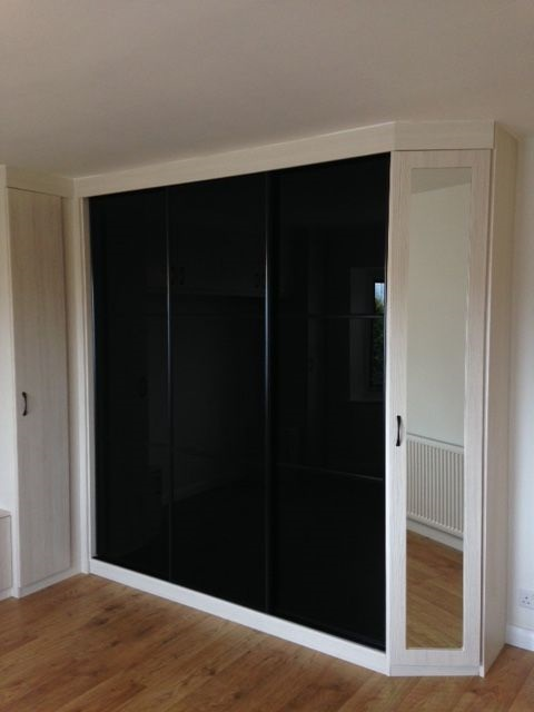 Black glass sliding wardrobe doors