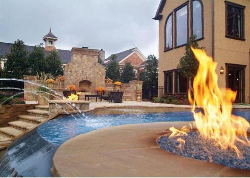 Outdoor-Stone-Fireplace-by-Pool_Blue-Haven_490x350