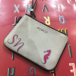 SN letters painted on Mimco