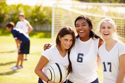 three girls in white football shirts.PNG