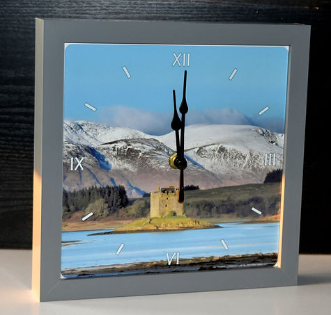 Handmade clock with seascape image behind the clock face.jpg