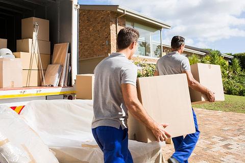 removal men carrying sofa
