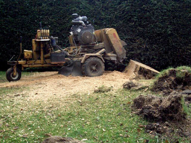 woodchipper surrounded by wood shavings.jpg