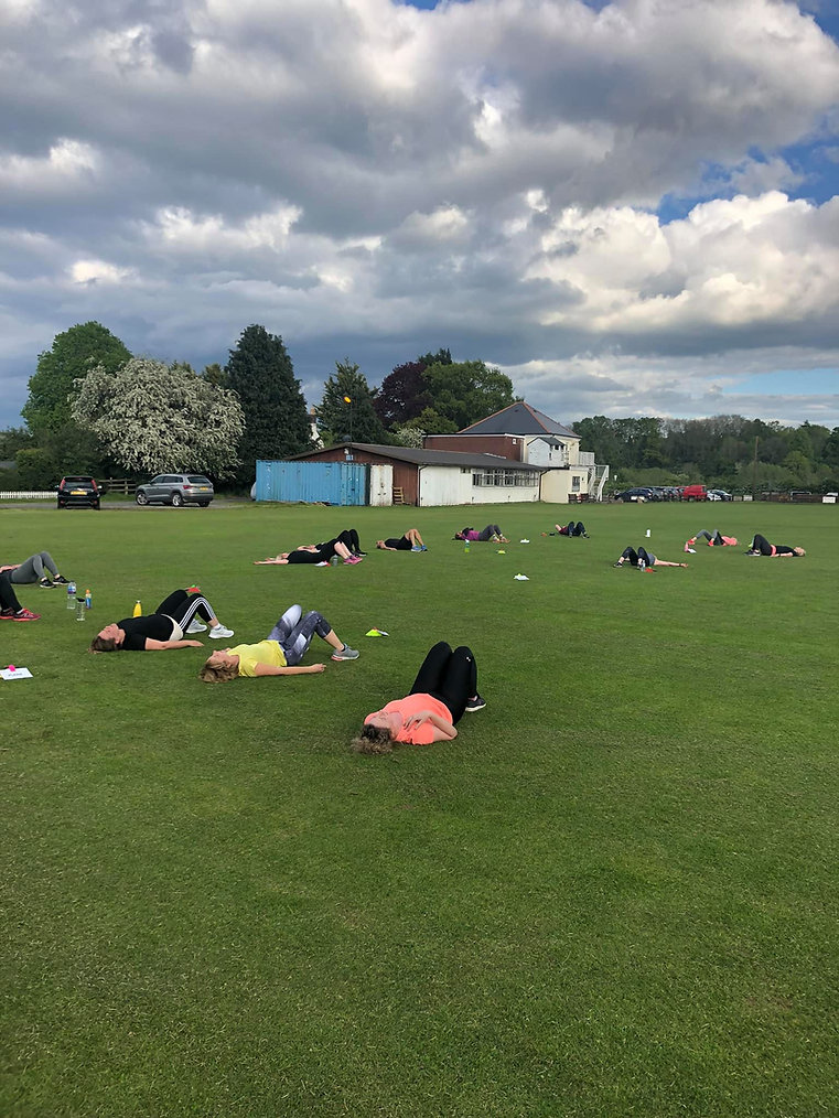 ladies laid on field after ab session.jpg