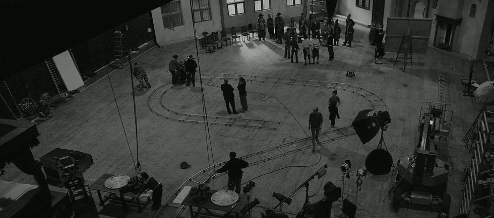 Black and white image of actors in filming studio, aerial view.jpg