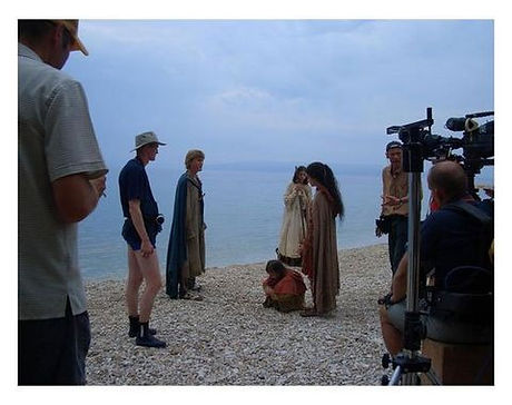 Actors and crew filming on a beach.jpg