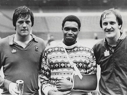 black and white image of 3 footballers