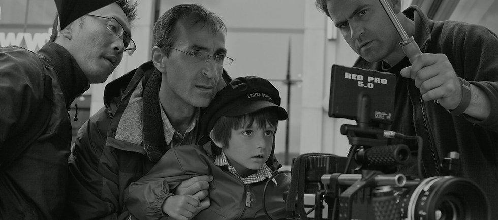 Actors and director looking through camera.jpg