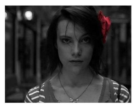 Actress in black and white with red flower in hair.jpg