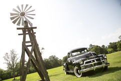 1954 Chevy Truck in Field with Windmill