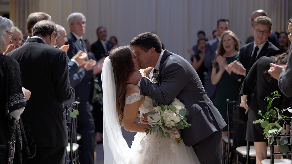 Treasury on the Plaza ceremony kiss