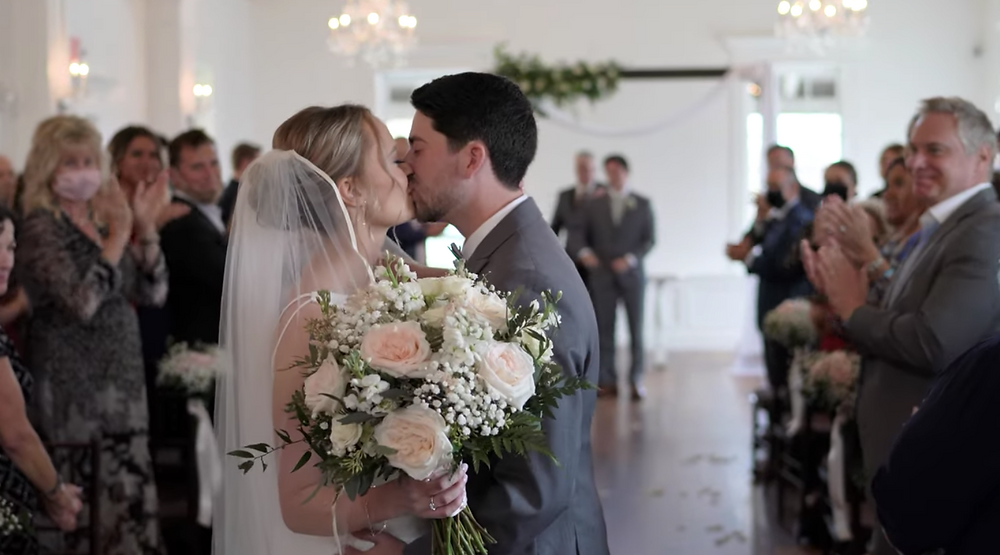 Couple Kisses at The White Room Villa Blanca during Wedding Ceremony