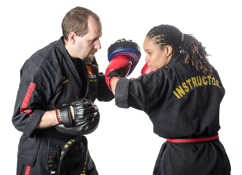 Man and woman with sparring gear