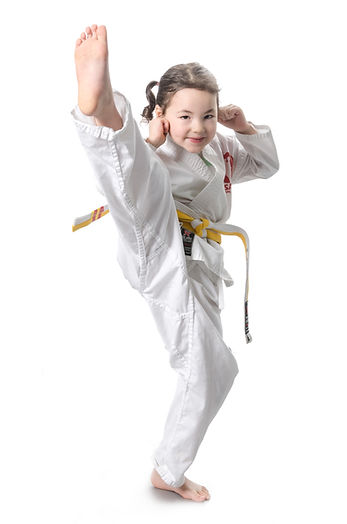 Young girl martial arts kick
