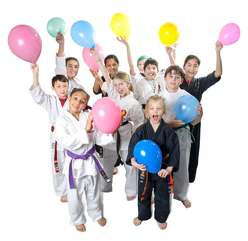 A group of young children at a birthday party in martial arts uniforms