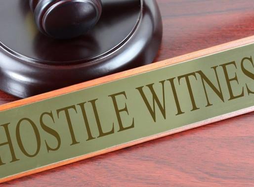 Who is hostile witness ?
