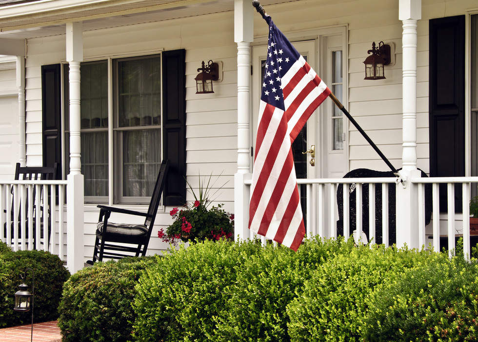 front porch of white colonial home with
