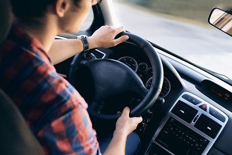 man driving a vehicle