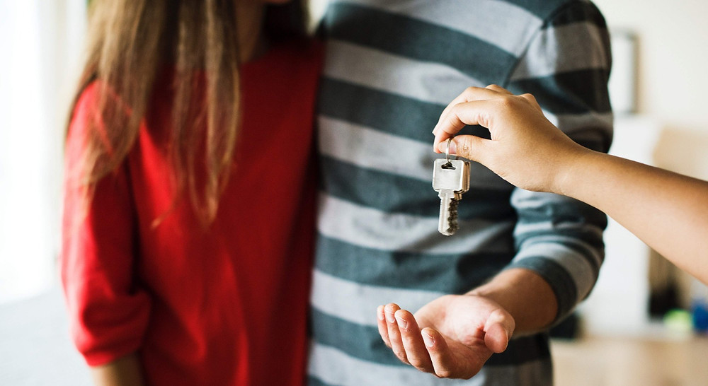 Couple being handed the keys to their new house