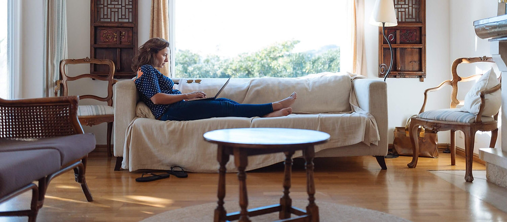 Woman sitting on her couch