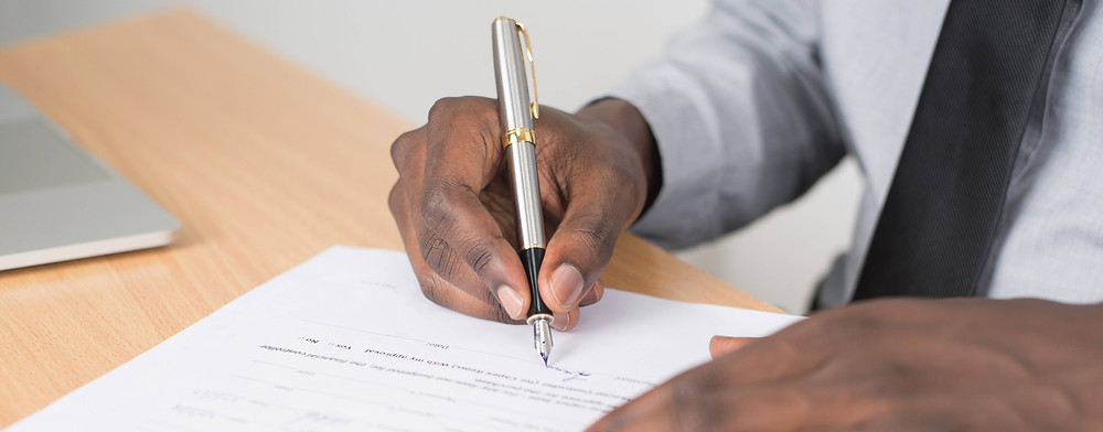 Investor signing an offer for a house