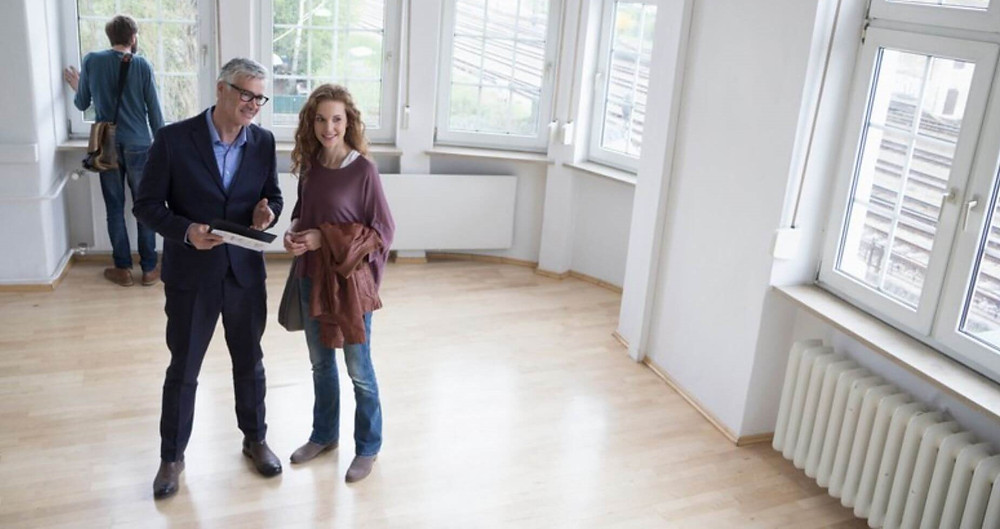 Man and woman touring an empty house