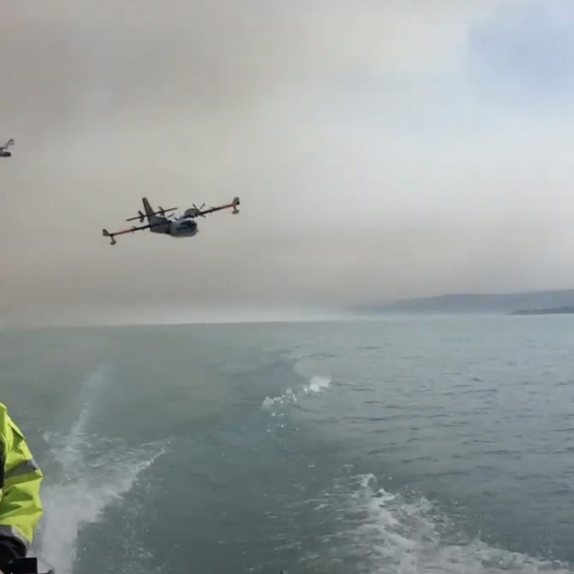 WATCH: This Super Scooper Skims Across Alaskan Lake to Fight Wildfire