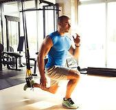 suspension-training-man-doing-leg-exerci