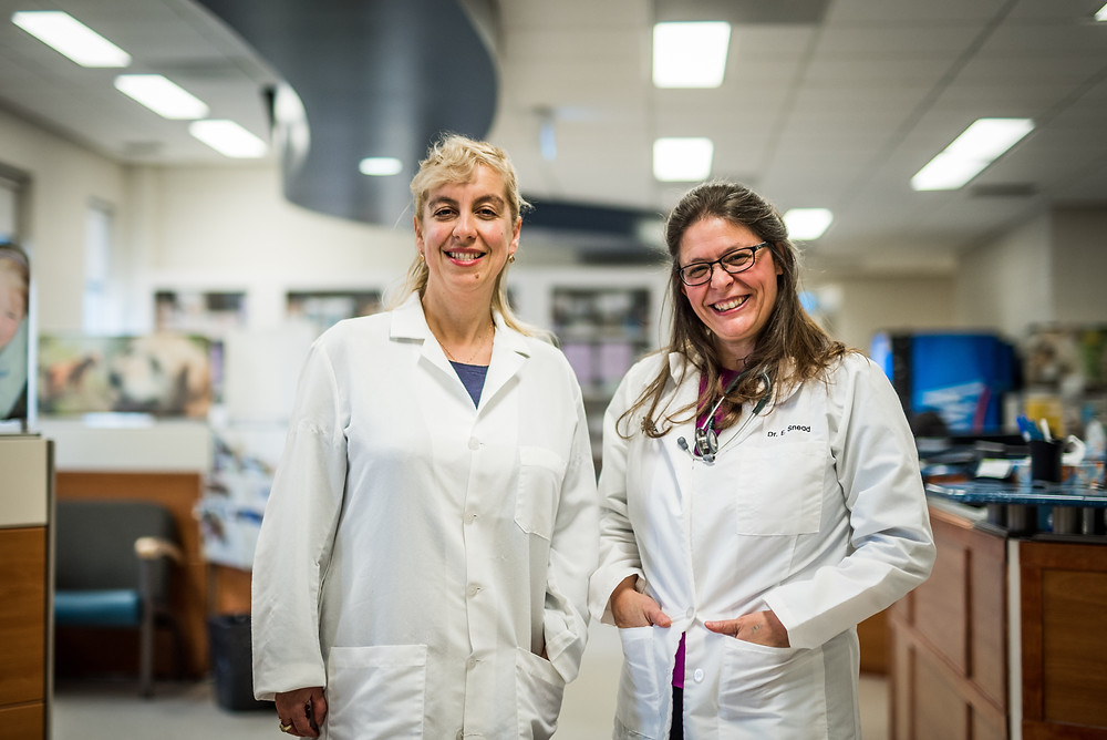 Two women scientists in lab coats