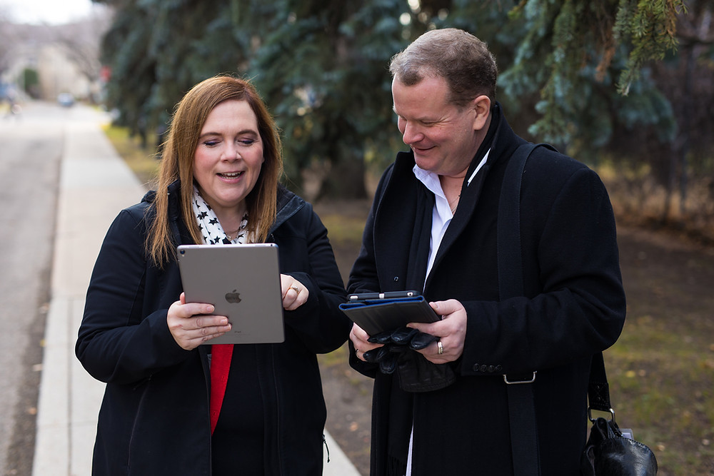 Tracie and Tyler review an electronic health record on their tablets.