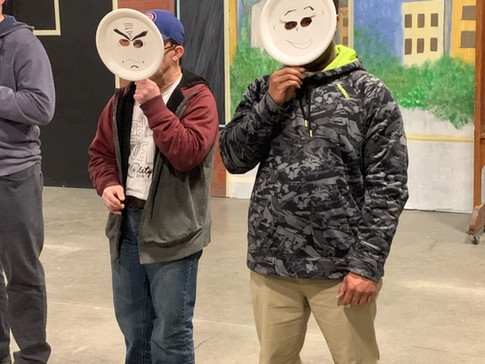 actors with paper plate masks