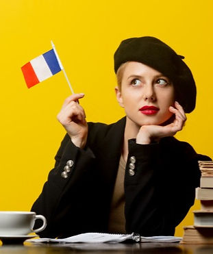 style-blonde-woman-beret-with-french-flag-books-around-yellow_87910-6683_edited.jpg