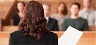 Woman-lawyer-in-front-of-jury.png