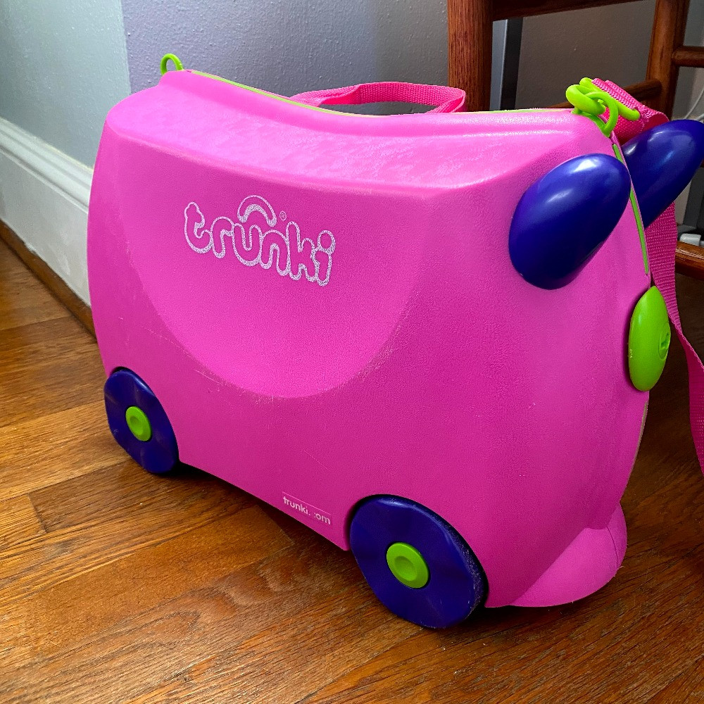 A child's pink Trunki suitcase