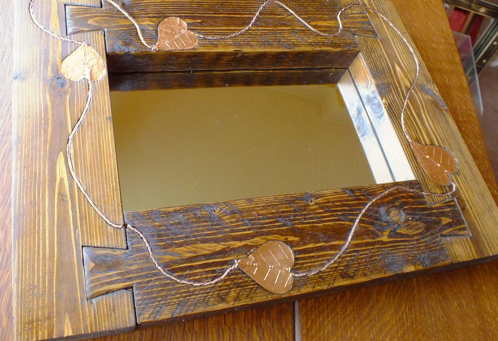 Reclaimed mirror dovetailed with copper details
